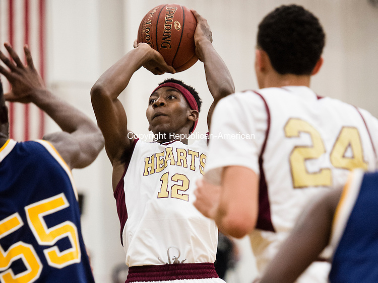 WATERBURY, CT- 8 January 2015-010816EC05-    Sacred Heart's Charles Fisher shoots from the outside Friday night. The Hearts defeated the Kennedy Eagles in front of a sold-out crowd, 96-49. Erin Covey Republican-American