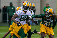 Green Bay Packers tight end Martellus Bennett (80) and cornerback Davon House (31) during an Organized Team Activity on May 23, 2017 at Clarke Hinkle Field in Green Bay, Wisconsin.  (Brad Krause/Krause Sports Photography)