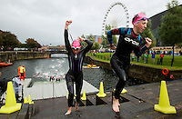 10 AUG 2014 - LIVERPOOL, GBR - Competitors head  for transition at the end of the swim during the elite womens wave at the Tri Liverpool triathlon in Kings Dock, Liverpool, Great Britain (PHOTO COPYRIGHT © 2014 NIGEL FARROW, ALL RIGHTS RESERVED)