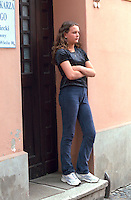 Girl age 17 standing in doorway with arms folded.  Torun Poland