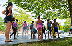 WATERBURY,  CT-071919JS15--  Children cool off after firefighters opened a fire hydrant in Berkeley Heights to on oppressively hot Saturday afternoon during a block party. The hydrant was opened by members of Waterbury Fire Department Engine 7 on Walnut Street. <br /> Jim Shannon Republican American