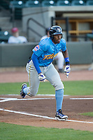 Rashad Crawford (20) of the Myrtle Beach Pelicans hustles down the first base line against the Winston-Salem Dash at BB&T Ballpark on April 18, 2016 in Winston-Salem, North Carolina.  The Pelicans defeated the Dash 6-4.  (Brian Westerholt/Four Seam Images)