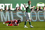 04/14/2011 - Eddie Johnson is issued a yellow card for tripping up Ugo Ihemelu as the Portland Timbers play FC Dallas during the Portland Timbers' second MLS home match at Jeld-Wen Field Sunday.  ..Photo by Christopher Onstott
