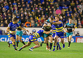 2nd February 2019, Halliwell Jones Stadium, Warrington, England; Betfred Super League rugby, Warrington Wolves versus Leeds Rhinos; Liam Sutcliffe is tackled by Chris Hill and Jack Hughes