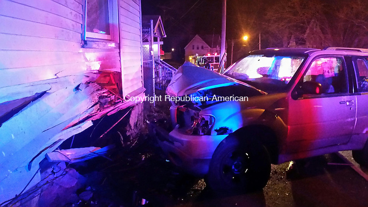 WATERBURY, CT, 30 November, 2015 - 113015LW01 - A 2001 Ford Explorer plowed into the three-family home at 370 Walnut St. in Waterbury just before 9 p.m. Monday. <br />