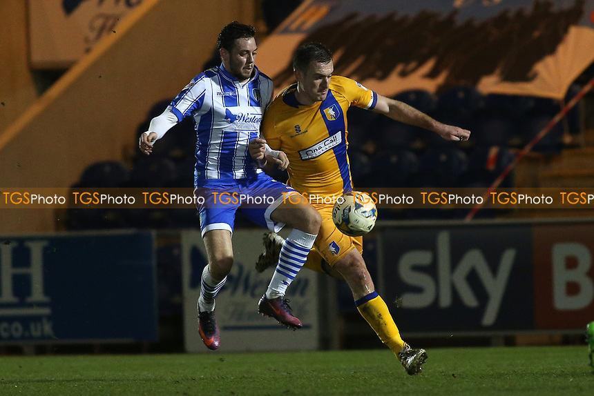 Drey Wright of Colchester United and Lee Collins of Mansfield Town during Colchester United vs Mansfield Town, Sky Bet EFL League 2 Football at the Weston Homes Community Stadium on 14th March 2017