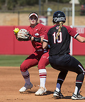 NWA Democrat-Gazette/BEN GOFF @NWABENGOFF<br /> Nicole Duncan (24), Arkansas second baseman, tags out Jana Johns of South Carolina on a fielder's choice in the first inning Sunday, March 17, 2019, at Bogle Park in Fayetteville.