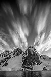 Backlit mountain peaks, Antarctic Peninsula, Antarctica