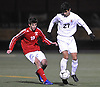 Michael Rodrigues #27 of Mineola, right, and Ryan D'Accordo #19 of South Side battle for possession during the Nassau County Class A varsity boys soccer semifinals at Adelphi University on Friday, Oct. 28, 2016.