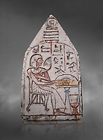 "Ancient Egyptian Ra stele , limestone, New Kingdom, 19th Dynasty, (1279-1190 BC), Deir el-Medina,  Egyptian Museum, Turin. Grey background.<br /> <br /> Akh iqer en Ra "" the excellent spirit of Ra' stele. The individual is smelling a lotus flower. One of three stele forund in different rooms of houses in Deir el-Medina where they stood in niches."