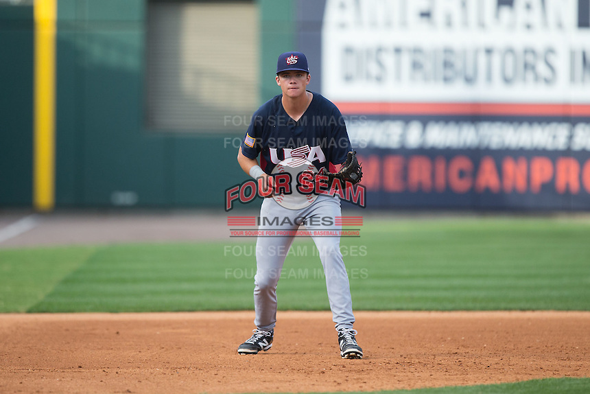 US Collegiate National Team third baseman Bobby Dalbec (24) on defense against the Cuban National Team at BB&T BallPark on July 4, 2015 in Charlotte, North Carolina.  The United State Collegiate National Team defeated the Cuban National Team 11-1.  (Brian Westerholt/Four Seam Images)