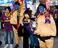 Barcelona soccer fans from Spain dressed in Sumo outfits at the World Club Championship in Yokohama.