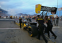 Oct 31, 2014; Las Vegas, NV, USA; Crew members push NHRA top fuel driver Richie Crampton during qualifying for the Toyota Nationals at The Strip at Las Vegas Motor Speedway. Mandatory Credit: Mark J. Rebilas-USA TODAY Sports