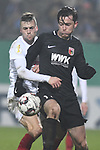 06.02.2019,  GER; DFB Pokal, Holstein Kiel vs FC Augsburg ,DFL REGULATIONS PROHIBIT ANY USE OF PHOTOGRAPHS AS IMAGE SEQUENCES AND/OR QUASI-VIDEO, im Bild Jonas Meffert (Kiel #26l) versucht sich gegen Michael Gregoritsch (Augsburg #11) durchzusetzenFoto © nordphoto / Witke *** Local Caption ***