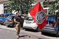 Roma 30 Maggio 2015<br /> Marcia commemorativa, al quartiere San Lorenzo, in onore del  Comandante Aleksey Mozgovoy,  uno dei leader carismatici della resistenza di Lugansk e Donetsk, comandante del battaglione Prizrak (fantasma) nell'autoproclamata Repubblica di Lugansk in Donbass ucciso in un attentato. Manifestante con la bandiera del battaglione Prizrak.<br /> Rome May 30, 2015<br /> Commemorative march, to the neighborhood of San Lorenzo, in honor of Captain Aleksey Mozgovoy, one of the charismatic leaders of the resistance of Lugansk and Donetsk, battalion commander Prizrak (ghost)  in self-proclaimed Republic of Lugansk in Donbass killed in an attack. Protester with the flag of the battalion Prizrak.