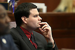 Nevada Assemblyman David Gardner, R-Las Vegas, works on the Assembly floor at the Legislative Building in Carson City, Nev., on Wednesday, April 1, 2015. <br /> Photo by Cathleen Allison