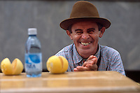 Orange juice vendor Assis Oliveira smiles from behind his pushcart in Manaus, Brazil, Saturday, January 7, 2006. (Kevin Moloney for the New York Times)