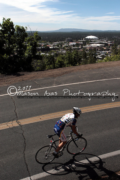 A rider heads up Mars Hill high above Flagstaff with the NAU campus in the distance.