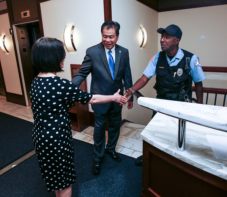 DePaul President A. Gabriel Esteban, Ph.D., center, introduces his wife Josephine to DePaul Public Safety officer Marques Ferrell during a tour of the Loop Campus Wednesday, July 5, 2017. (DePaul University/Jamie Moncrief)