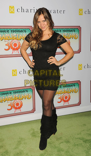 Luciana Faulhaber.arriving at Charlie Ebersol's 'Charlieland' Birthday Party And Charity: Water Fundraiser at a private residence in Los Angeles, California, USA..December 8th, 2012.full length black lace dress boots hands on hips.CAP/ROT/TM.©Tony Michaels/Roth Stock/Capital Pictures