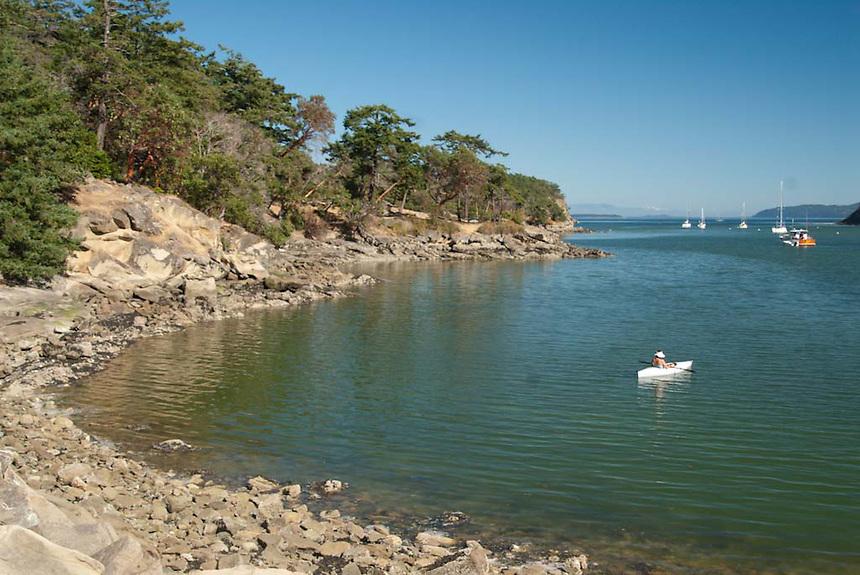 Kayaker off Sucia Island, San Juan Islands, Washington, US