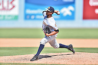 Charleston RiverDogs pitcher Daris Vargas (9) delivers a pitch during a game against the Asheville Tourists at McCormick Field on July 10, 2016 in Asheville, North Carolina. The Tourists defeated the RiverDogs 4-2. (Tony Farlow/Four Seam Images)
