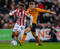 7th March 2020; Bet365 Stadium, Stoke, Staffordshire, England; English Championship Football, Stoke City versus Hull City; Sean McLoughlin of Hull City attempts to tackle Tyrese Campbell of Stoke City