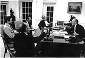 United States President Gerald R. Ford (right) enjoys a light moment with his senior staff in the Oval Office at the White House on May 14, 1975.  (Left to Right) National Security Advisor Robert (Bud) McFarlane; National Security Advisor Brent Scowcroft; White House Chief of Staff Donald Rumsfeld; and United States Secretary of State Henry Kissinger.<br /> Mandatory Credit: David Hume Kennerly / White House via CNP