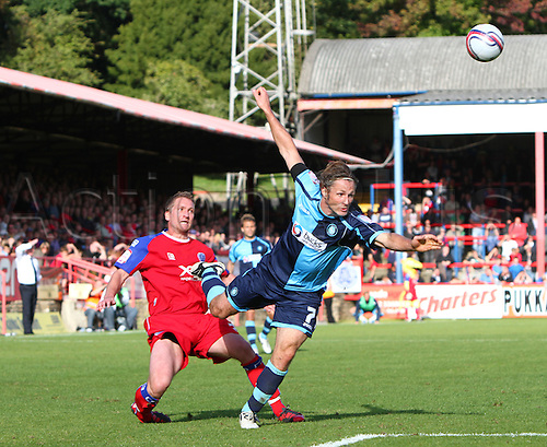 18/09/2010. Wycombe's Gareth Ainsworth (blue shirt) is sent flying by a second half tackle from an Aldershot defender. Aldershot Town v Wycombe Wanderers. Division 2 match at the Recreation Ground, Aldershot, Hampshire, England.