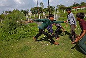 Village boys play kabbadi outside the school in village Gaura, outskirts of Bhopal, Madhya Pradesh, India.