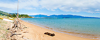 Panoramic Photo of Tata Beach Surrounded by Mountains, Golden Bay, South Island, New Zealand. This panoramic photo shows Tata Beach, a stunning beach located in the Golden Bay Region of South Island, New Zealand. The golden sand and turquoise water make is a truely beautiful beach to visit.