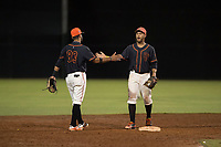 AZL Giants Black infielders Enoc Watts (83) and Jose Rivero (2) celebrate after turning a double play during an Arizona League game against the AZL Angels at the San Francisco Giants Training Complex on July 1, 2018 in Scottsdale, Arizona. The AZL Giants Black defeated the AZL Angels by a score of 4-2. (Zachary Lucy/Four Seam Images)