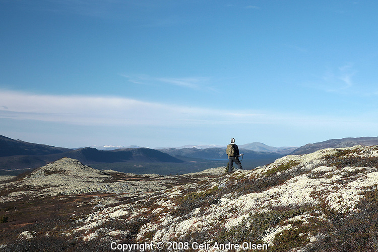 Lonely hunter enjoying the view of Rondane National Park in Norway