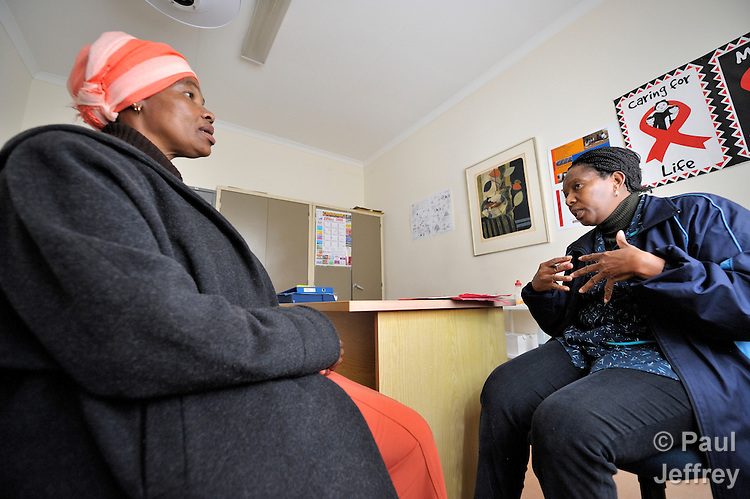 Emily Dube (right), a counselor at the St. Francis Care Centre in Johannesburg, South Africa, talks with Nompumelelo Ngebeza before testing her for HIV. The centre is a project of the Roman Catholic Archdiocese of Johannesburg, and is supported by Catholic Relief Services, a member of the Ecumenical Advocacy Alliance.