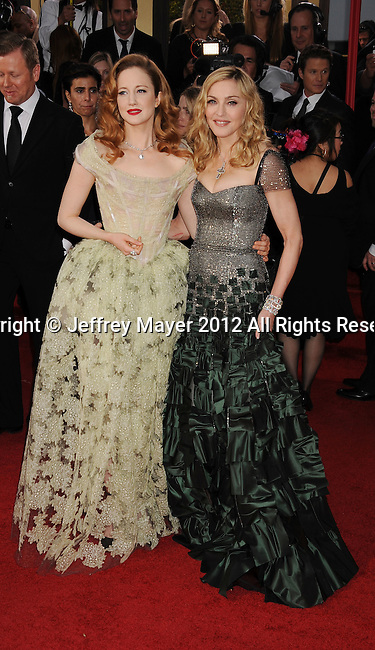 BEVERLY HILLS, CA - JANUARY 15: Madonna and Andrea Riseborough arrive at the 69th Annual Golden Globe Awards at The Beverly Hilton hotel on January 15, 2012 in Beverly Hills, California.