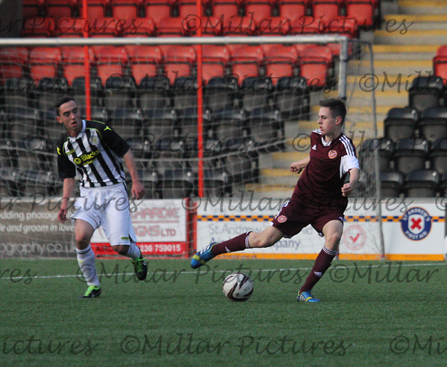 Liam Smith passing watched by Anton Brady in the St Mirren v Heart of Midlothian Scottish Professional Football League Under 20 match played at Excelsior Stadium, Airdrie on 1.10.13.