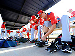24 February 2012: Washington Nationals' pitcher Tyler Clippard laces up at the Carl Barger Baseball Complex in Viera, Florida. Mandatory Credit: Ed Wolfstein Photo