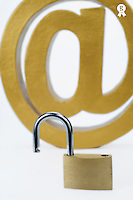 Internet unsafe, at sign and unlocked padlock (Licence this image exclusively with Getty: http://www.gettyimages.com/detail/102170466 )