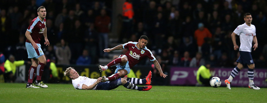 Preston North End's Tom Clarke and Burnley's Matthew Lowton<br /> <br /> Photographer Stephen White/CameraSport<br /> <br /> Football - The Football League Sky Bet Championship - Preston North End v Burnley - Friday 22nd April 2016 - Deepdale - Preston <br /> <br /> &copy; CameraSport - 43 Linden Ave. Countesthorpe. Leicester. England. LE8 5PG - Tel: +44 (0) 116 277 4147 - admin@camerasport.com - www.camerasport.com
