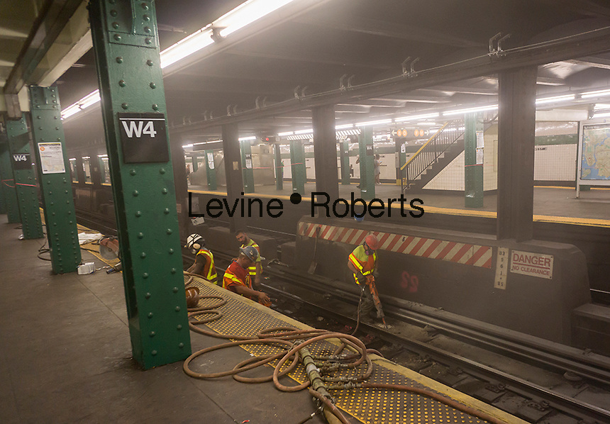 MTA workers in the West Fourth Street subway station do weekend work on the the track bed on Saturday, August 20, 2016.  (© Richard B. Levine)