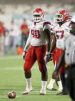 Manatee Hurricanes lineman Demarcus Christmas #90 and Derrick Calloway #57 before a play during the first quarter of the Florida High School Athletic Association 7A Championship Game at Florida's Citrus Bowl on December 16, 2011 in Orlando, Florida.  The score at halftime is Manatee 17 - First Coast 0.  (Mike Janes/Four Seam Images)