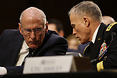 """Director Daniel Coats, Office of the Director of National Intelligence (ODNI) and Director General Robert Ashley, Defense Intelligence Agency (DIA) confer as they testify before the United States Senate Select Committee on Intelligence during an open hearing on """"Worldwide Threats"""" on Capitol Hill in Washington, DC on Tuesday, January 29, 2019.<br /> Credit: Martin H. Simon / CNP"""