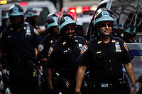 Police officers patrol street while protesters of the Occupy Wall Street movement celebrate their first anniversary with marches and confrontations with the New York police where 150 protesters have been arrested during weekend celebrations in Manhattan.  Photo by Eduardo Munoz Alvarez / VIEWpress.