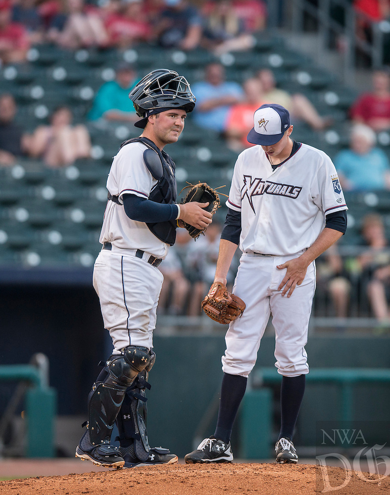NWA Democrat-Gazette/ANTHONY REYES &bull; @NWATONYR<br /> Cam Gallagher (35) of the Northwest Arkansas Naturals talks with pitcher Matt Strahm (25) at the mound against Midland Thursday June 30, 2016 at Arvest Ballpark in Springdale.