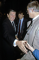 Washington DC., USA, 1981<br /> President Ronald Reagan works a rope line shaking hands with children after going out to dinner. Credit: Mark Reinstein/MediaPunch