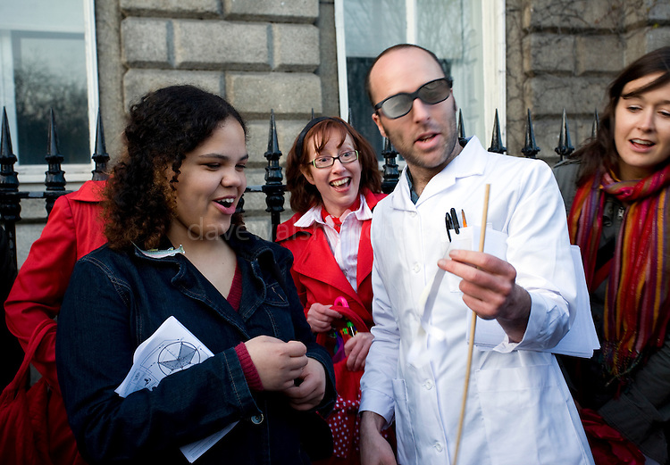 Professor Coyle does Moebius Strip Experiments outside the School of Cosmic Physics, Dublin Institude for Advanced Studies in Merrion Square, during the Walking Tour of Places of No Historical Interest, Festival of Fools, April 1st 2009, marking April Fool's Day, and the 43rd anniversary of the death of Irish author Flann O'Brien
