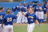 UC-Riverside Highlanders Connor Cannon (50) receives a helmet bump from teammates Dean Miller (20) and Matt Hardy (36) after hitting a home run at Riiverside Sports Complex on May 26, 2018 in Riverside, California. The Cal Poly SLO Mustangs defeated the UC Riverside Highlanders 6-5. (Donn Parris/Four Seam Images)