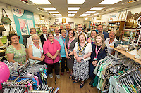 PDSA Shop Manager Moira Earley (centre) and Mayor of Erewash Coun. Val Custance celebrate with PSDA Staff and Volunteers at the re-opened Long Eaton shopp