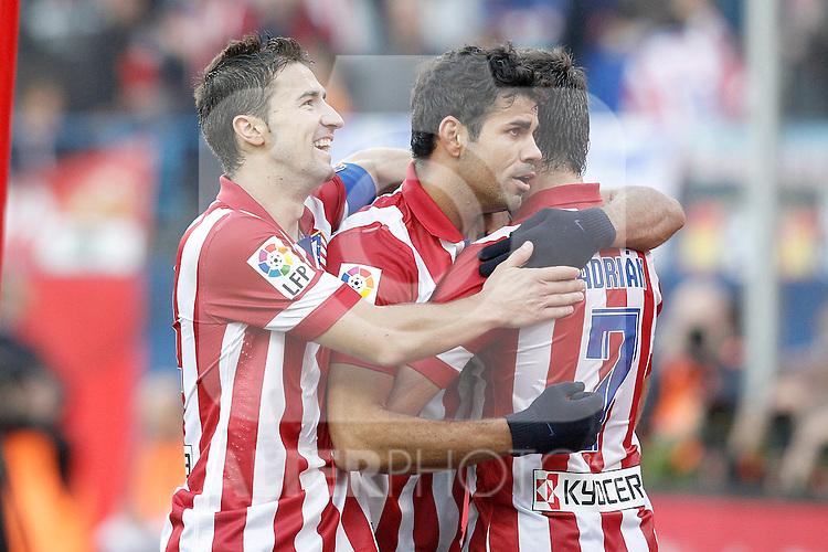 Atletico de Madrid's Diego Costa (c), Gabi Fernandez (l) and Adrian Lopez celebrate goal during La Liga match.November 3,2013. (ALTERPHOTOS/Acero)