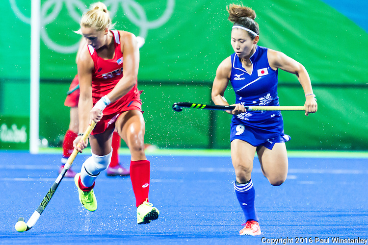 Kelsey Kolojejchick #7 of United States protects the ball from Yuri Nagai #9 of Japan during USA vs Japan in a Pool B game at the Rio 2016 Olympics at the Olympic Hockey Centre in Rio de Janeiro, Brazil.